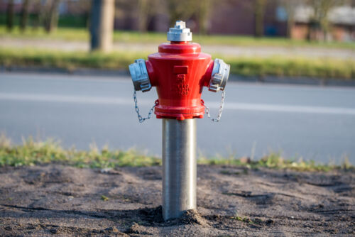 Red fire hydrant. City street. Fire hidrant for emergency fire access